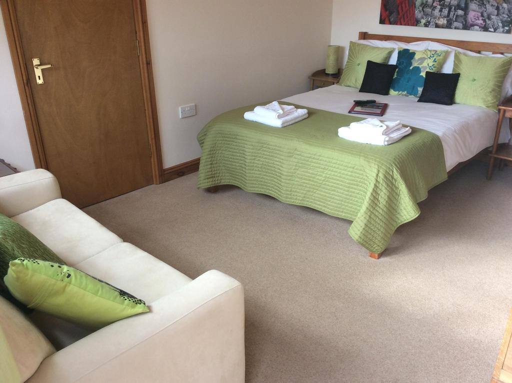 Family Room (1 Double, 2 Adults + Sofa Bed, 2 Children Under 12) including breakfast