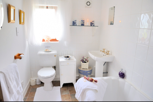 Bathroom -one of 3 Bathrooms with Bath, overhead Shower, Toilet,