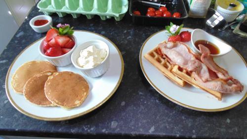 Homemade pancakes, strawberries and cream