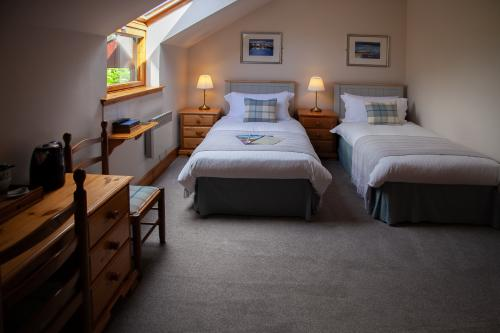 Room 10. A twin en-suite room with Hillside Garden view - one night surcharge.