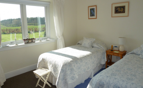 Double Bedroom 2 with twin beds facing south over the Cheviot Hi