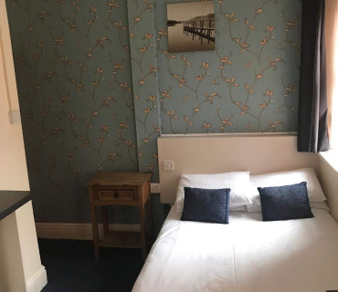 Room with smaller double bed with breakfast