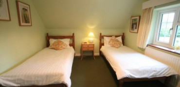 Single occupancy First floor Twin room(has use of shared ground floor bathrooms) £50.00 per night